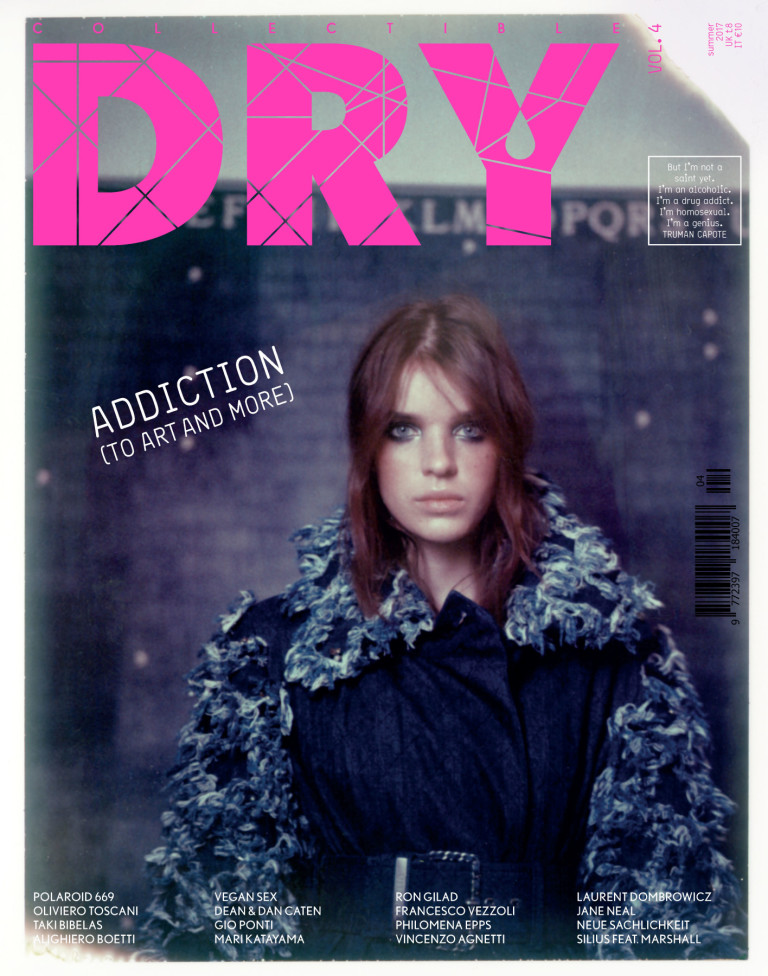 Cover issue 4 Collectible DRY. Marli, actor, model and muse, is wearing a Chanel denim belted trench coat with decorated sleeves and collar; as a backdrop, a masterpiece of Alighiero Boetti, Mettere al mondo il mondo, 1972-73.