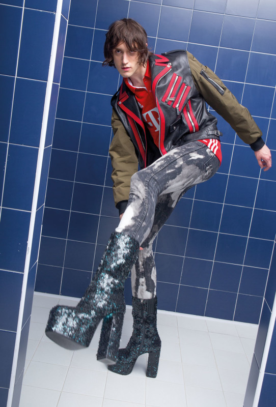 DANCING IN THE EYE OF THE HURRICANE ph. Lorenzo Marcucci for Collectible DRY Edouard wears leather and nylon biker jacket and sequined boots DSquared2, soccer polo shirt Adidas Originals, jeans Wrangler customized by stylist.