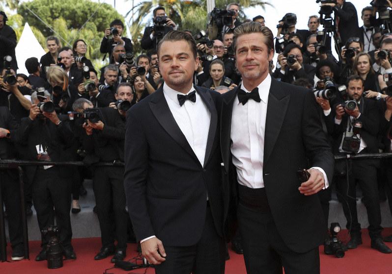 Leonardo Di Caprio and Brad Pitt on Cannes Film Festival's red carpet, Photo by Vianney Le Caer/Invision/AP