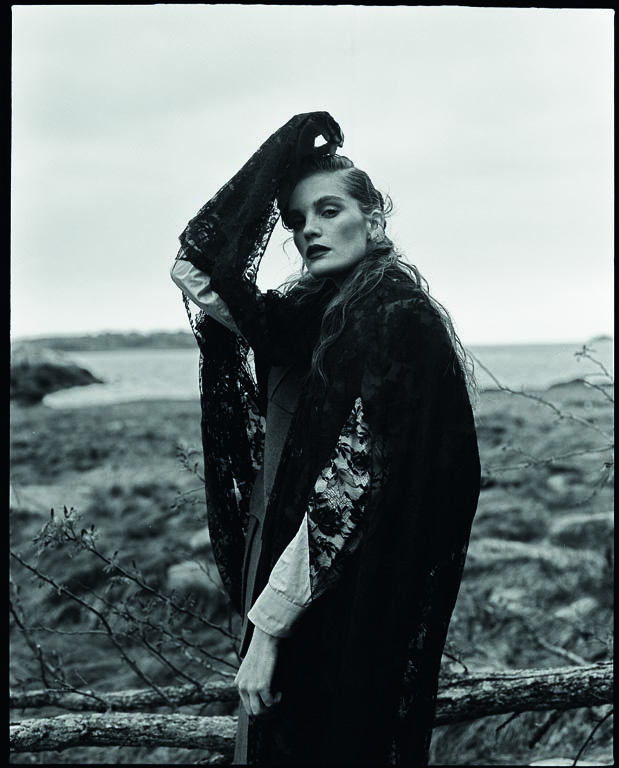 Alexina wears cape, coat and shirt Prada, earrings Ella Gafter NY