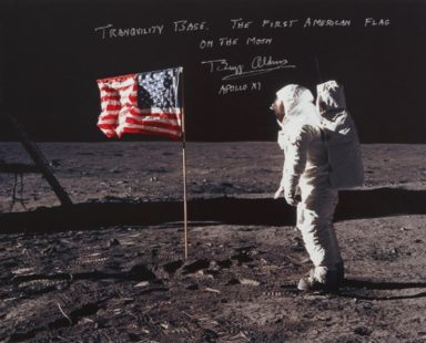 [APOLLO 11]. ALDRIN WITH THE STARS AND STRIPES. COLOR PHOTOGRAPH, SIGNED AND INSCRIBED BY BUZZ ALDRIN, Courtesy of Sotheby's