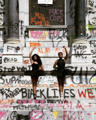 2020 and Still a Matter of Colour_Black Lives Matter_George Floyd_revolution_USA_protests_police_people_resistance_movement _Ballerinas Kennedy George and Ava Holloway, pose in front of a monument of Confederate general Robert E. Lee