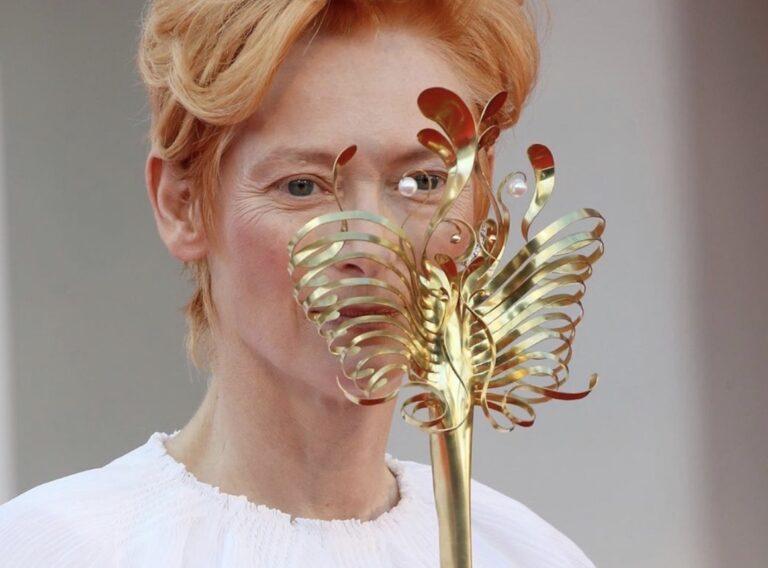 Tilda and Stacy_Venice Film Festival 2020_77 edition_premieres_Tilda Swinton_actress_Leone d'Oro prize_winner_Chanel dress_godeln Venetian mask