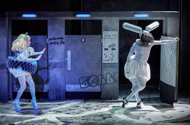 Carly Bawden as 'Alice' and Joshua Lacey as the white rabbit in Wonder.land, Royal National Theatre, London 2015. © Costume design by Katerina Lindsay, 2015. Design by Rae Smith. Photo Brinkhoff/Moegenbur