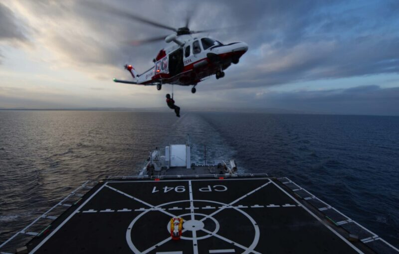 RESCUE TRAINING EXERCISE BY HELICOPTER AT SEA